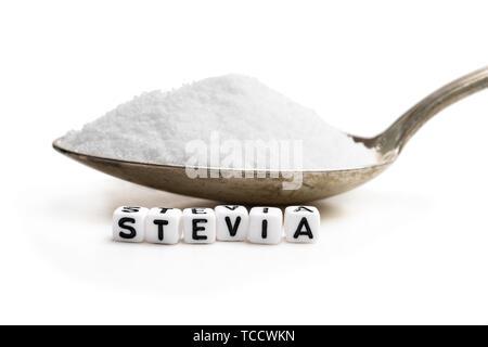 Spoon  full of sugar substitute stevia. No sugar concept - Stock Image