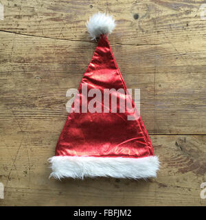 High Angle View Of Santa Hat On Table - Stock Image