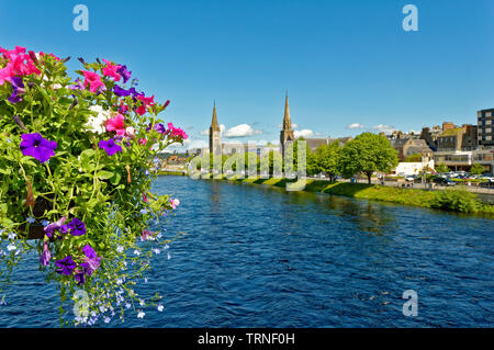 INVERNESS CITY SCOTLAND VIEW OVER RIVER NESS FROM NESS ROAD BRIDGE WITH HANGING BASKET AND PETUNIA FLOWERS - Stock Image