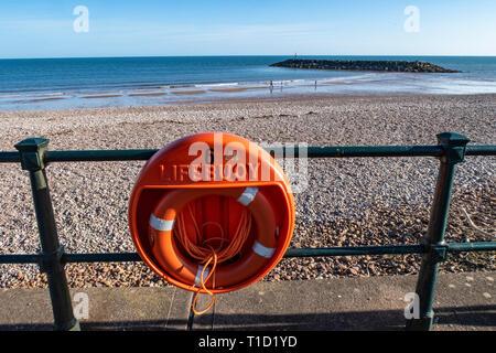 A lifebuoy on the esplanade at Sidmouth, Devon, UK. Lifebelt.Lifering. - Stock Image