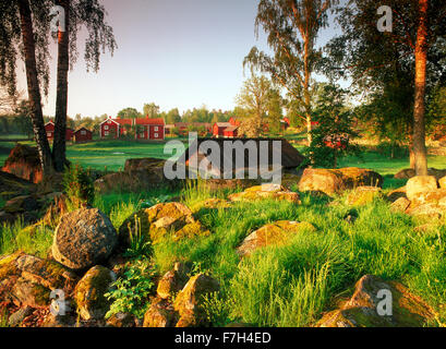 Traditional red farm houses and barns at village of Stensjöby in Småland, Sweden - Stock Image