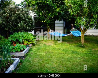 Hammocks in the garden - Stock Image