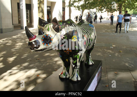 London, UK. 2 1 August 2018. R hino​ ​ Marjorie ​ ​ painted by Eileen Cooper, at  Paternoster Square / St Paul's, part of the 21 Tusk Rhino Trail installations on display in London. The rhinos, embellished by the internationally renowned artist will be on display until World Rhino Day on 22 September to raise awareness of the severe threat of poaching to the species' survival. They will then be auctioned by Christie's on 9 October to raise funds for the Tusk animal conservation charity. Credit: David Mbiyu / Alamy Live News - Stock Image