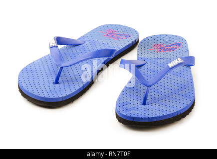 KRASNODAR, RUSSIA - July 26, 2018: Blue Nike flip flops isolated on a white background, showing the wite Nike logo and, illustrative editorial - Stock Image