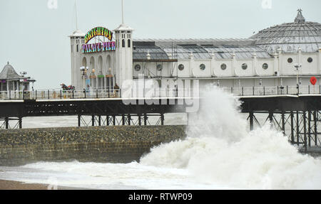 Brighton, East Sussex, UK. 3rd March 2019 .Waves crash onto Brighton seafront by the pier as Storm Freya batters parts of Britain today Credit: Simon Dack/Alamy Live News - Stock Image