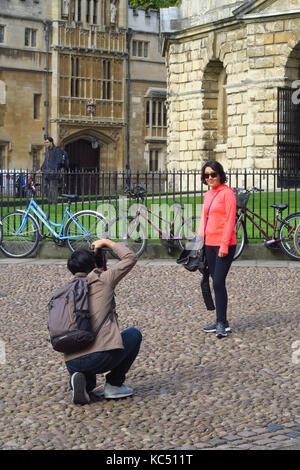 Touists taking photographs of themselves outside the Radcliffe Camera, Radcliffe Square Oxford - Stock Image