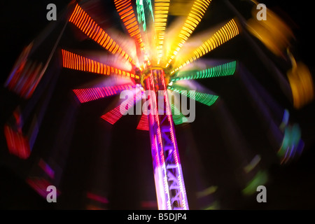 USA. A photograph of the swings ride, captured at night, at the local fair. This image was taken with special in - Stock Image