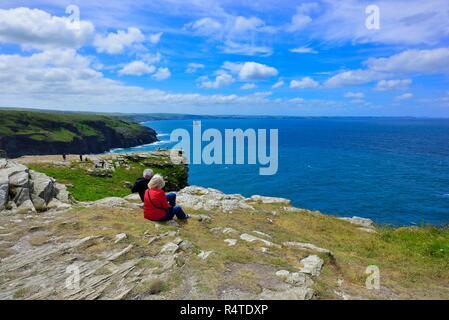 Tourists enjoying the view,Tintagel castle Island Peninsula,Cornwall,England,UK - Stock Image
