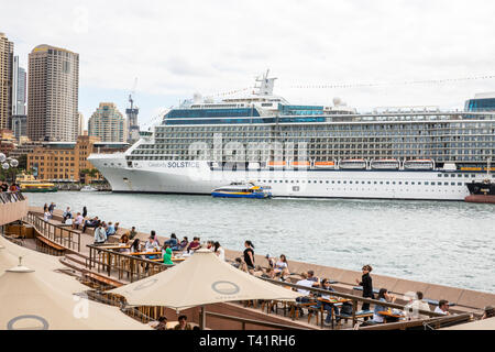 Sydney Circular Quay, cruise ship Celebrity Solstice moored at the quay with people relaxing at the Opera terrace bar,Sydney,Australia - Stock Image