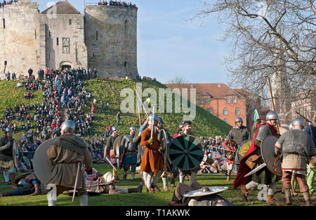 Battle between Vikings and Anglo Saxons at the Viking Festival Clifford's Tower York North Yorkshire England UK United Kingdom GB Great Britain - Stock Image