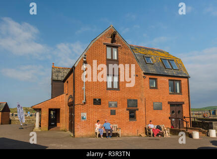 A red brick building on North Quay, Padstow, Cornwall, England - Stock Image
