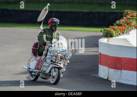 Chichester, West Sussex, UK. 14th Sep, 2013. Goodwood Revival. Goodwood Racing Circuit, West Sussex - Saturday 14th September. Mod driving a heavily modified Vespa with additional lights and mirrors negotiates the chicane during a Mods, Rockers and Police parade on the track. Credit:  MeonStock/Alamy Live News - Stock Image