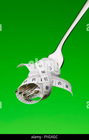 Fork with Tape Measure Dieting Concept Obesity - Stock Image
