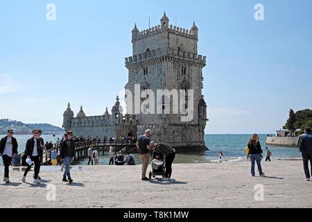 Teens and families people tourists visitors visiting Belem Tower on a beautiful spring day and River Tagus riverside in Lisbon Europe  KATHY DEWITT - Stock Image