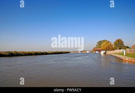 A view of the lower reaches of the River Bure on the Norfolk Broads at Stokesby, Norfolk, England, United Kingdom, Europe. - Stock Image