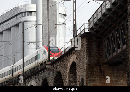 Zurich, Switzerland, train of the Swiss Federal Railways drives on a viaduct - Stock Image