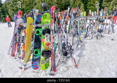 LAKE LOUISE, CANADA - MAR 23, 2019: Colorful ski rack at Lake Louise where skiers and snowboarders stow their equipment. - Stock Image