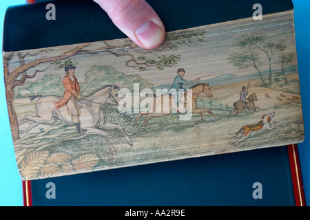 Antique book with Art Work on book Pages - Stock Image