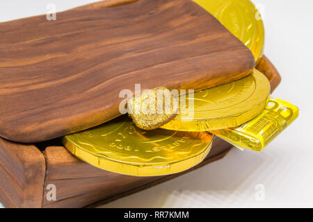 Closed treasure chest cake with chocolate coins - Stock Image