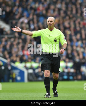 Referee Mike Dean during the Premier League match between Brighton & Hove Albion and Huddersfield Town at the American Express Community Stadium . 02 March 2019 - Stock Image
