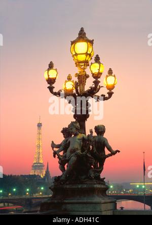 France Paris Pont Alexandre III Eiffel Tower Laterne angel sculptures at dusk - Stock Image