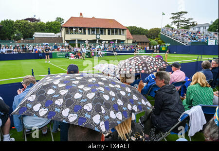 Eastbourne UK 24th June 2019 - The umbrellas come out as rain interrupts play during the Nature Valley International tennis tournament at Devonshire Park in Eastbourne . The forecast is for a heatwave along with thunder storms to arrive in Britain from mainland Europe with temperatures expected to reach the 30s in some parts of the south east. Credit : Simon Dack /TPI / Alamy Live News - Stock Image