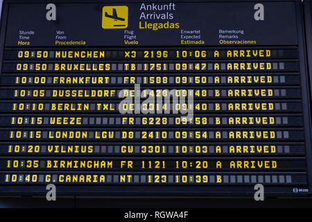 Arrivals timetable notification board at Reina Sofia Tenerife south airport, Canary Islands, Spain - Stock Image