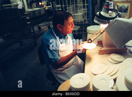 Worker inside the Waterford Wedgwood pottery Stoke on Trent Staffordshire England. The company including Wedgwood - Stock Image