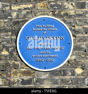 Blue plaque on brick wall of building that housed the private apartment & offices of famous Charles Dickens magazine Westminster London England UK - Stock Image