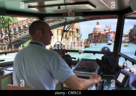 Vaporetto water-bus driver, Venice, Italy - Stock Image