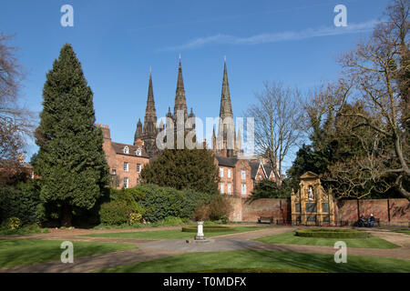 Lichfield Cathedral seen from the Remembrance garden in Lichfield. - Stock Image