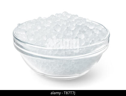 Glass bowl full of silica gel granules isolated on white - Stock Image