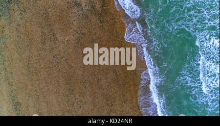 Aerial top down view of waves on the beach in Brighton and Hove, Southern England - Stock Image