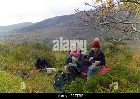 Walkers on the north side footpath beside  Loch Affric Glen Affric, Highlands, Scotland. - Stock Image