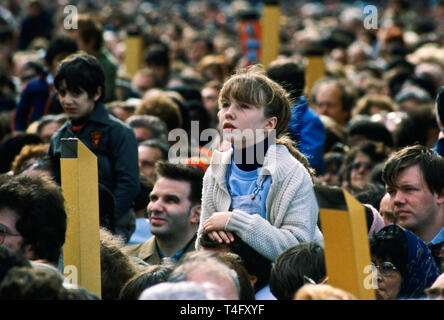 Child among crowd of pilgrims gathered in Paris for visit by Pope John Paul II to France - Stock Image