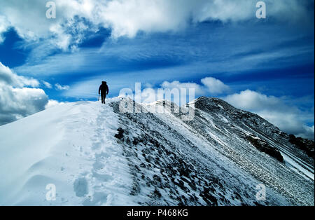 A climber on the long summit ridge of Beinn a Bheithir in the Scottish Highlands, Scotland - Stock Image