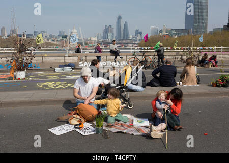 Climate Change protestors with Extinction Rebellion block Waterloo Bridge and simultaneously stop traffic across central London including Marble Arch, Piccadilly Circus, Waterloo Bridge and roads around Parliament Square, on 15th April 2019, in London, England. - Stock Image