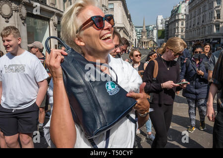 London, UK. 19th April 2019. Dame Emma Thompson shows her 'There is No Planet B' bag at Extinction Rebellion's Sea of Protest in Oxford Circus around large pink yacht, names after the Honduran environmental activist Berta Cáceres, assassinated in 2016. She came as a part of the activities to show 'Love For The Earth' on the 5th day of the occupation, but which were interrupted by police shortly after she spoke. Credit: Peter Marshall/Alamy Live News - Stock Image