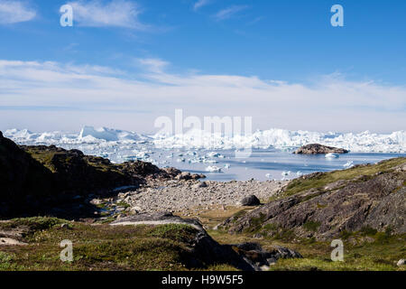Ilulissat Icefjord or Isfjord with enormous icebergs from Jakobshavn or Sermeq Kujalleq Glacier. Ilulissat Western - Stock Image