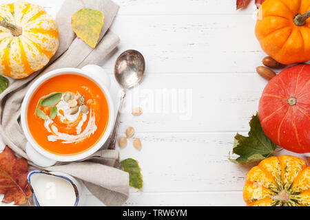 Autumn vegetarian pumpkin cream soup. Top view with copy space - Stock Image