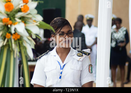 Abidjan, Ivory Coast - August 3, 2017: Epaulets ceremony for students leaving the Maritime Academy. a hostess of the standing navy watching over the s - Stock Image