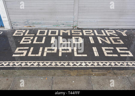 Tiles in front of Bloomsbury Building Supplies, Marchmont, Street, Camden, London, WC1, UK - Stock Image