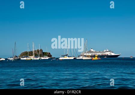 Gustavia harbor entrance with anchored sailboats and large cruise ship, Saint Barthelemy - Stock Image