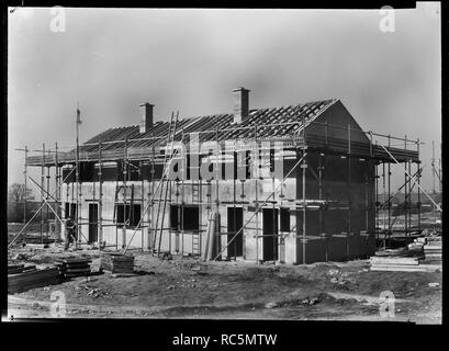 Houses under construction, Penhill, Swindon, Wiltshire, 1953. A pair of semi-detached Easiform houses under construction on the Penhill Estate. Laing's Easiform houses were built up until the 1960s and are formed of concrete panels rather than traditional brick, stone or blockwork. The houses shown here are very similar in design to those at numbers 1 and 2 Bratton Close. - Stock Image