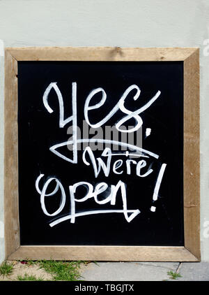 Yes, we are open sign. On outdoor cafe - Stock Image