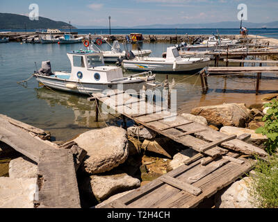 Old and rusty traditional fishing boats in the Limenas Harbour in Thasos, Greece - Stock Image