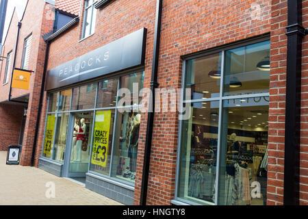 Peackocks discount clothes store shop UK England sign above door - Stock Image