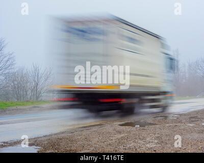 Long exposure big van passing-by blurry image photo - Stock Image