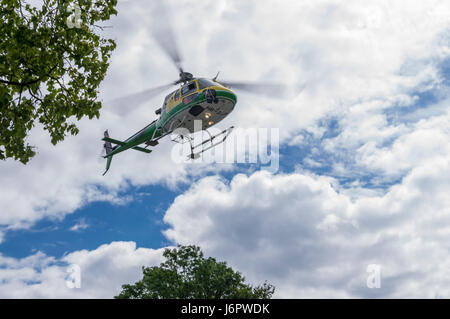 Airbus Helicopters (Aérospatiale/Eurocopter) AS350 B3 'Écureuil' in the air, seen from below. - Stock Image