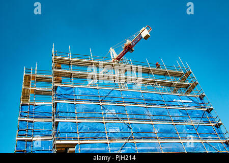 Gosford, New South Wales, Australia - August 4. 2018: Construction and building progress update 116.  A working tower crane on new home units building - Stock Image